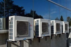 AC units lined up along building